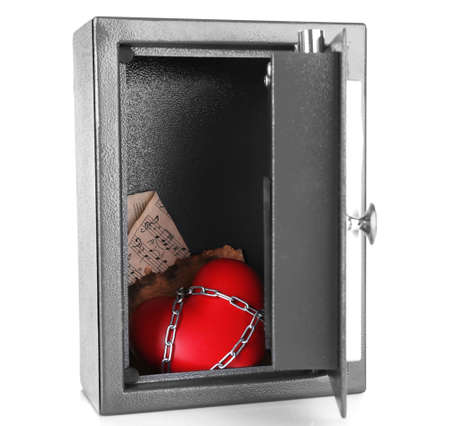 stainless steal: Decorative heart with old paper in safe isolated on white