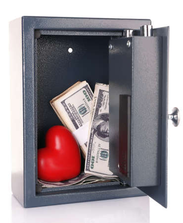 Decorative heart with money in safe isolated on white Stock Photo