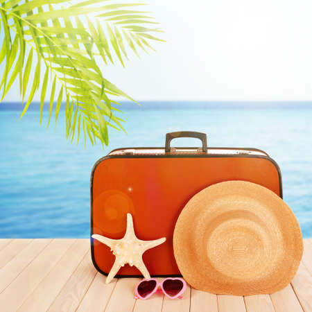 hamedoreya: Vintage valise with summer items on wooden board on sea background Stock Photo