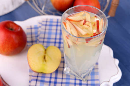 non alcoholic beverage: Glass of apple cider with fruits on table close up