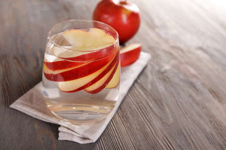 non alcoholic beverage: Glass of apple cider with fruits on wooden background