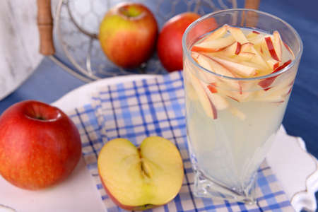 non alcoholic: Glass of apple cider with fruits on table close up