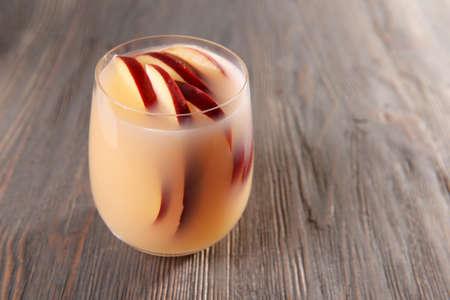 cider: Glass of apple cider on wooden background