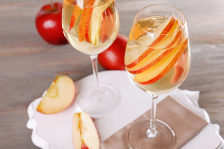 non alcoholic beverage: Glasses of apple cider with fruits on table close up
