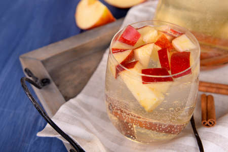 non alcoholic beverage: Glass of apple cider with fruits and spices on table close up