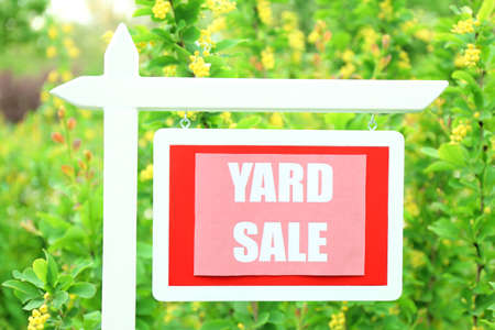 yard sign: Wooden Yard Sale sign over green grass background Stock Photo