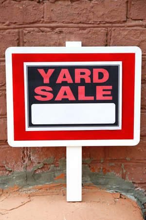 yard sign: Wooden Yard Sale sign on red brick wall background Stock Photo
