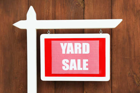 yard sign: Wooden Yard Sale sign on wooden fence background Stock Photo