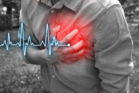 Man having chest pain - heart attack, outdoors Standard-Bild