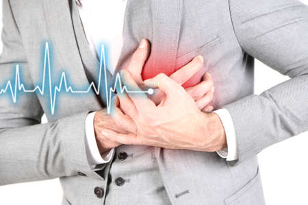 enfermedades del corazon: Man having chest pain - heart attack, close up