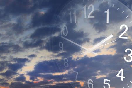 day light: Clock face in bright sky Stock Photo