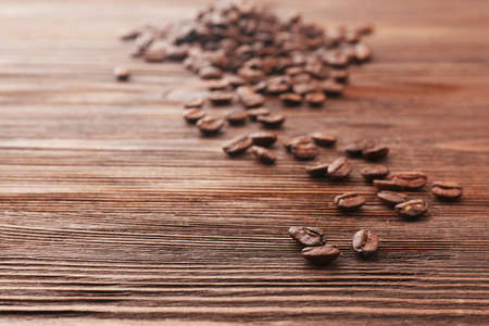 brown backgrounds: Coffee beans on wooden background