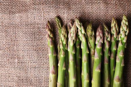 sackcloth: Fresh asparagus on sackcloth background