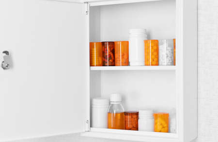 medical decisions: Medicine chest with bottles of pills, closeup
