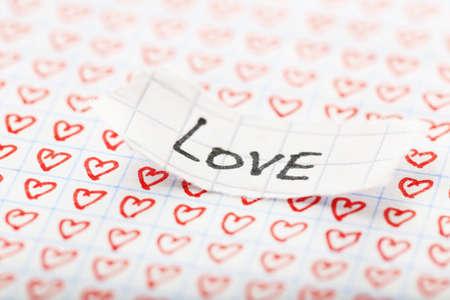 torn heart: Word LOVE written on torn paper on heart background