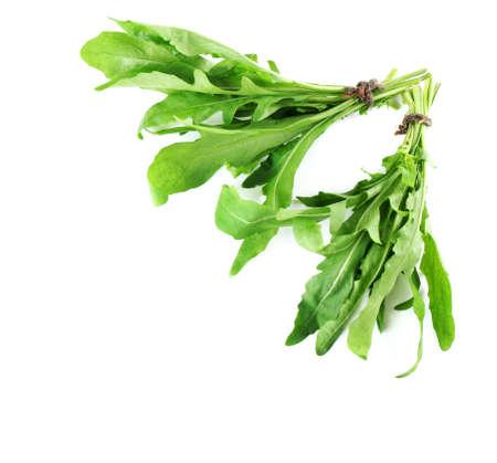 rukola: Bunch of fresh arugula leaves isolated on white