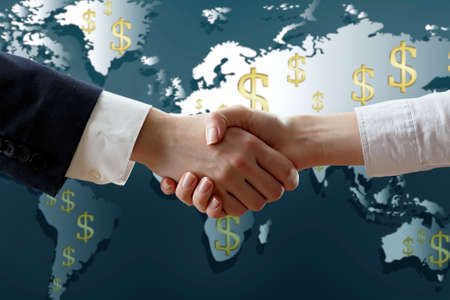 woman holding money: Business success strategy concept.Business handshake on world map background Stock Photo