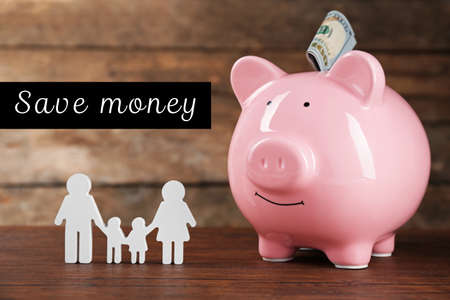 pay wall: Pig money box and paper decor on wooden wall background