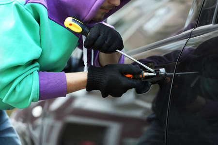 burglar man: Man burglar stealing car