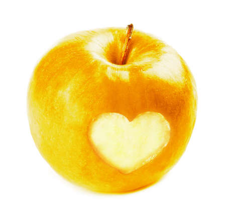 yellow apple: Yellow apple with heart isolated on white Stock Photo