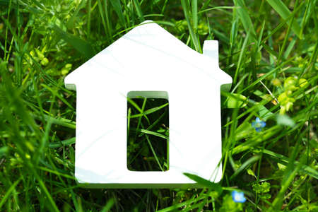 toy house: Toy house on grass background Stock Photo
