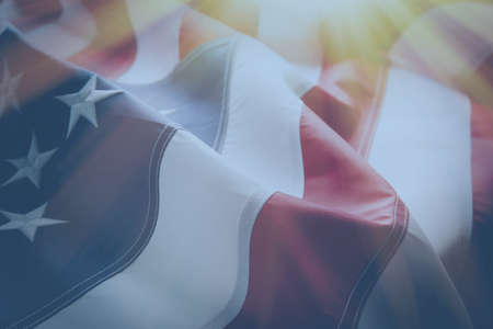 American flag background with sunlight