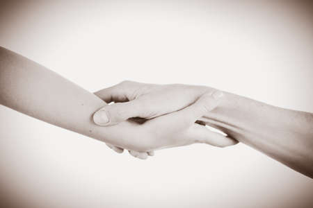 each: Two hands reaching toward each other. Helping concept. Vintage tone
