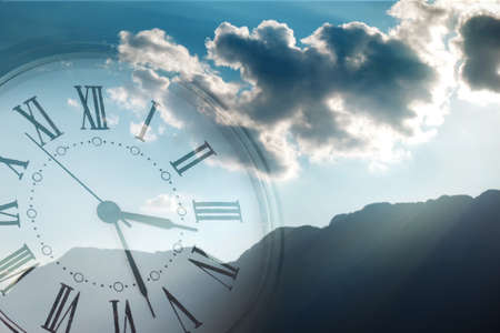 bright sky: Clock face in bright sky Stock Photo