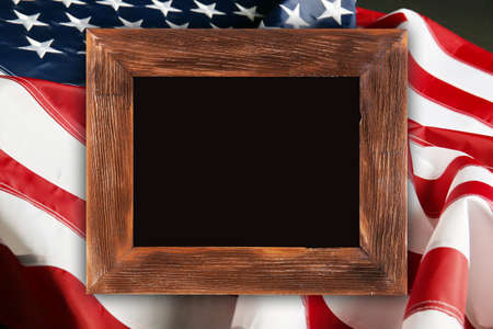 Wooden frame on American flag background