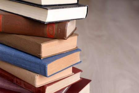 law book: Heap of old books on wooden background Stock Photo