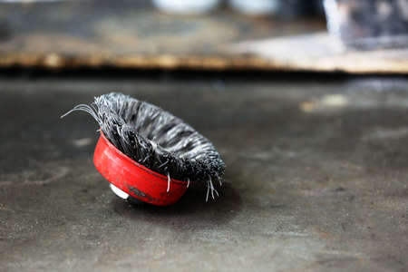 working stiff: Small metal brush on table close up Stock Photo