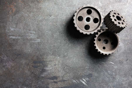 Group of rusty transmission gears on table close up