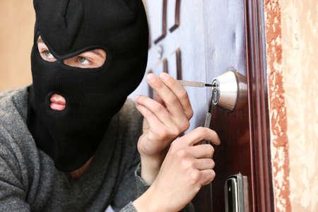 perpetrator: Burglar breaking into house