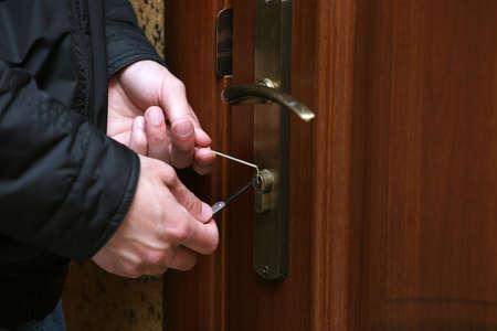 delinquent: Burglar breaking into house