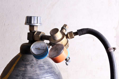 gas cylinder: Welding gas cylinder pressure gauge close up Stock Photo