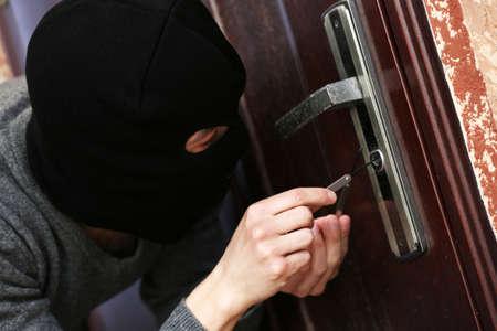law breaker: Burglar breaking into house