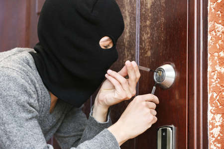 law breaker: Burglar breaking into house
