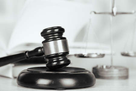judge hammer: Wooden judges gavel on wooden table, close up. Retro stylization