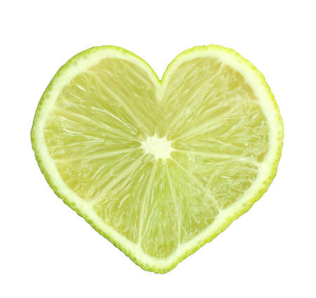 lime slice: Slice of fresh lime in heart shape, isolated on white