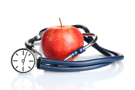 ultimatum: Medical stethoscope with clock and red apple isolated on white Stock Photo