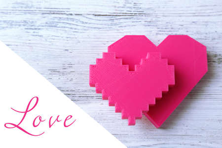 romance strategies: Plastic hearts on wooden background Stock Photo