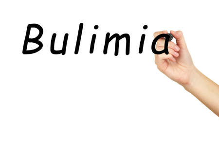 bulimia: Human hand writing word Bulimia on transparent whiteboard