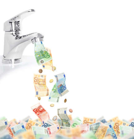 Money fall out of the tap isolated on white