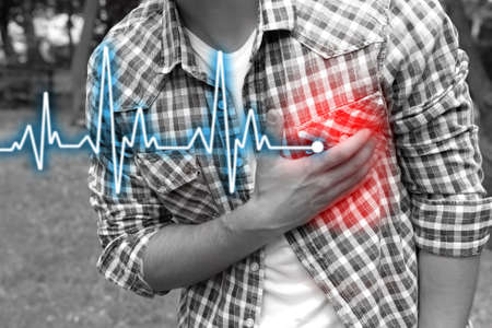 medical heart: Man having chest pain - heart attack, outdoors Stock Photo