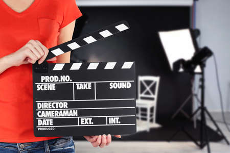 Operator holding clapperboard during the production of the film indoors Stock Photo