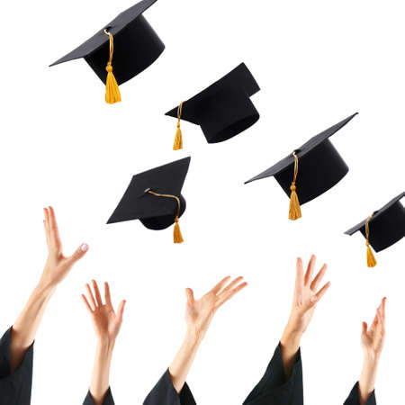 graduation background: Graduates hands throwing graduation hats , isolated on white