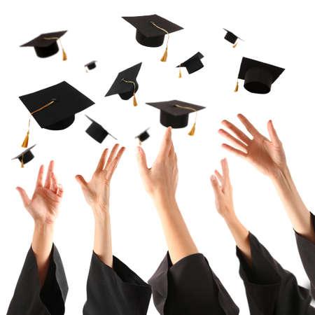 graduating seniors: Graduates hands throwing graduation hats , isolated on white