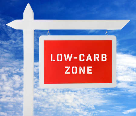 frame less: Low-Carb Zone text on wooden pointer on cloudy sky background Stock Photo