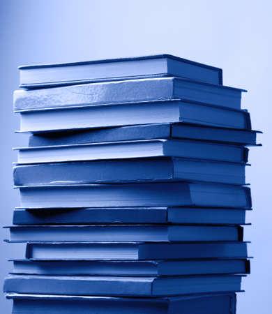 secretary tray: Stack of blue books on light blue background