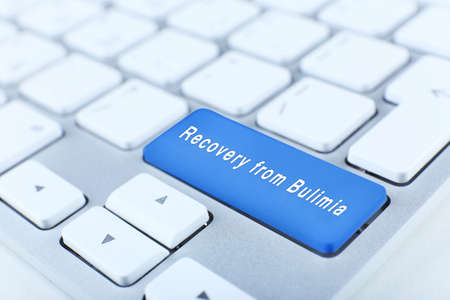 bulimia: Close up of Recovery from Bulimia keyboard button Stock Photo